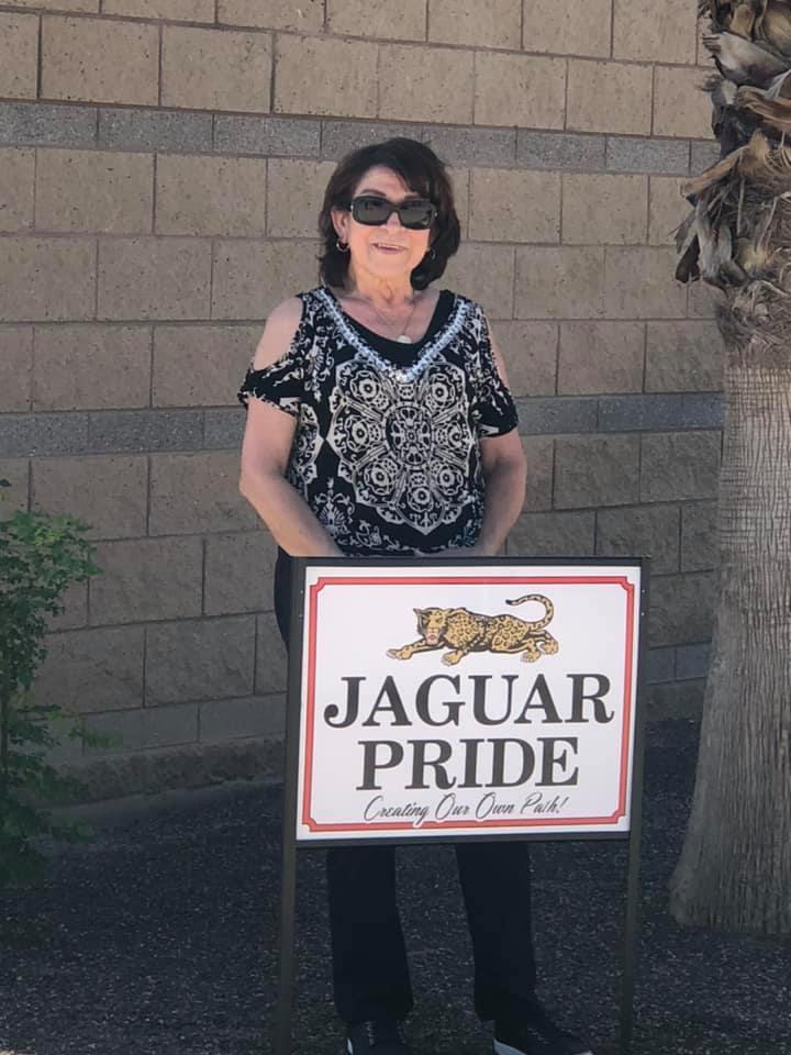woman in front of school sign