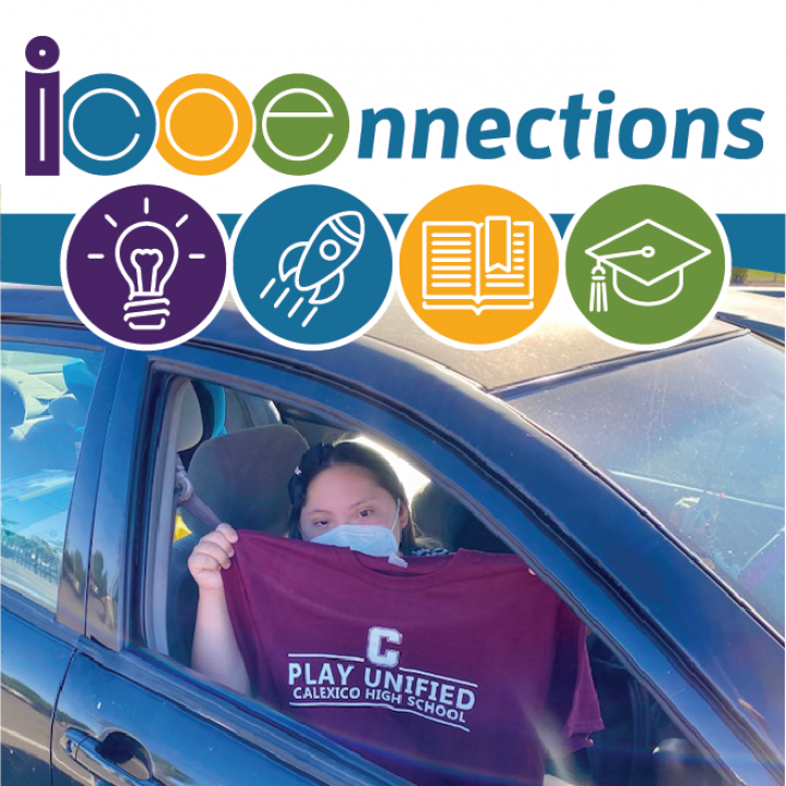 student in car holding t-shirt